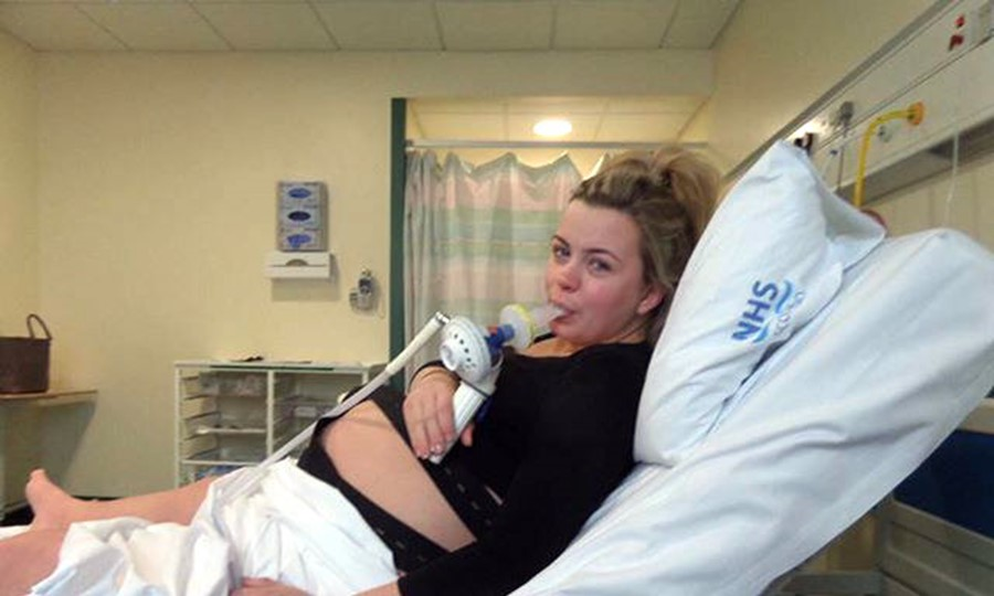 Pregnant Rhiannon lies on a hospital bed after receiving lifesaving blood donations