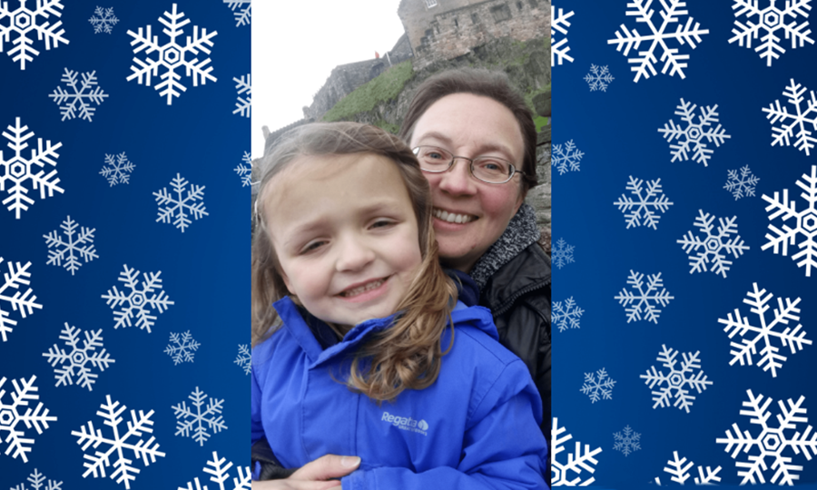 Amelia, aged five, smiling and healthy, poses with her mum outside Edinburgh castle.